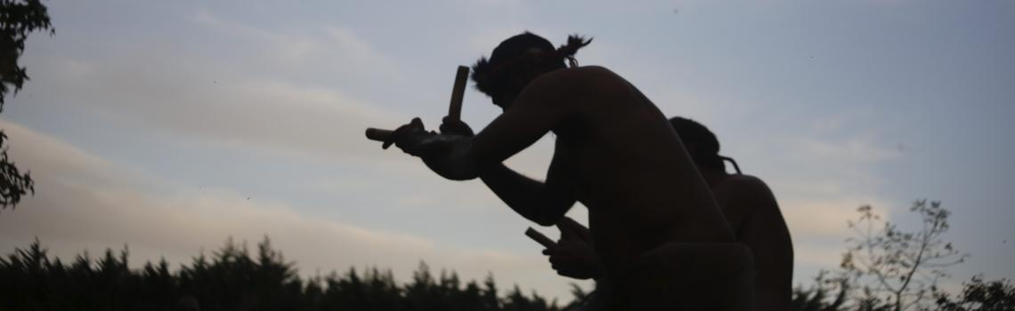 Indigenous dancer silhouetted against the sky at Armagh, launch of Our Uluru Response. / Credit: Reuben Daaman