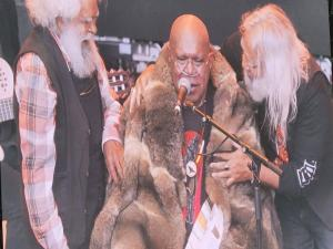Singer-songwriter Archie Roach is honoured with a possum skin cloak at 'Sharing the Spirit' festival in Melbourne, 26 January 2021. Photo: Andrew Flynn