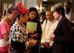 Calmy-Rey speaking with participants from Burma attending the Caux Forum